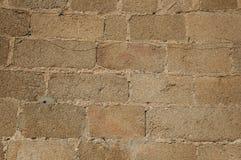 Pared hecha de los ladrillos de piedra, formando un modelo encantador en Caceres imágenes de archivo libres de regalías