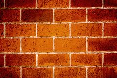 Pared hecha de los ladrillos sólidos rojos Foto de archivo