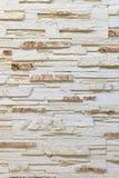 Pared hecha de piedra marrón clara decorativa Adornamiento para la chimenea Fondo Fotografía de archivo