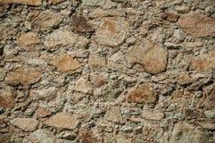 Pared hecha de piedras ?speras fotografía de archivo libre de regalías