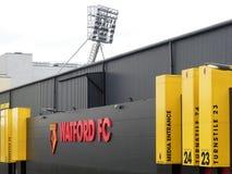 Pared lateral del estadio del club del fútbol de Watford, camino de empleo, Watford fotos de archivo libres de regalías