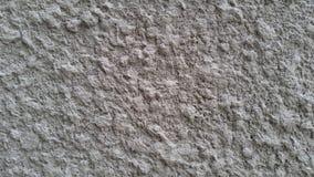 Pared llena de protuberancias blanca del cemento Foto de archivo
