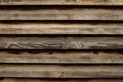 Pared marrón rústica hecha de tablones de madera Fondo natural Foto de archivo libre de regalías