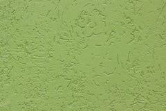Pared pintada áspera plana verde con muchas cavidades Textura inconsútil utilizado como fondo fotografía de archivo libre de regalías