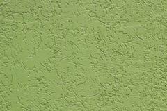 Pared pintada áspera plana verde con muchas cavidades utilizado como fondo fotos de archivo libres de regalías
