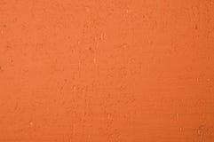 Pared pintada anaranjada vibrante Foto de archivo libre de regalías