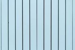 Pared pintada azul del tablero de madera Fotos de archivo libres de regalías