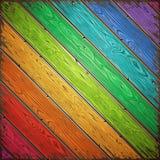 Pared pintada de madera vieja del arco iris Fotos de archivo libres de regalías
