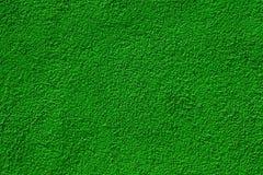 Pared pintada verde en la iluminación brillante imagen de archivo
