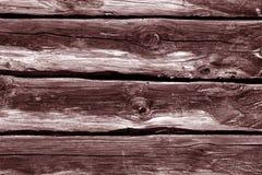 Pared roja de la cabaña de madera Foto de archivo