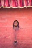 Pared roja sagrada Imagenes de archivo