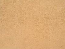 Pared textured enyesada marrón arenosa abstracta como Ba Fotografía de archivo libre de regalías
