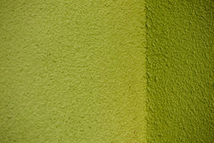 Pared verde del yeso con la textura de la esquina detrás Imágenes de archivo libres de regalías