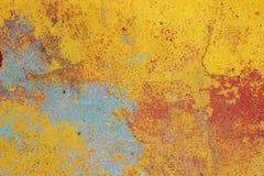 Pared vieja con el yeso coloreado peladura, textura Fotografía de archivo