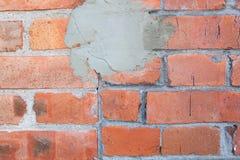 Pared vieja de la piedra para el uso como fondo o la textura con una mancha del cemento imagenes de archivo