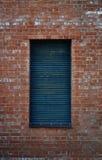 Pared y ventana anaranjadas Fotografía de archivo libre de regalías