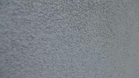 A parede é pintada no emplastro cinzento filme