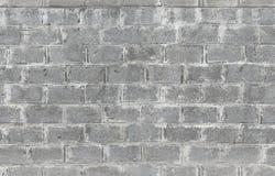 Parede cinzenta feita dos blocos de cimento Textura sem emenda imagem de stock