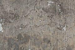Parede cinzenta velha do estuque com emplastro rachado Textura do fundo Foto de Stock Royalty Free