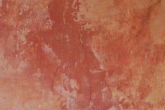 Parede colonial com pintura vermelha desvanecida Imagem de Stock