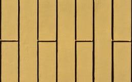 Parede com fundo amarelo do emplastro Imagem de Stock Royalty Free