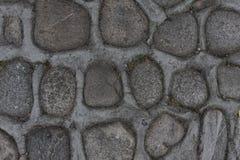 Parede da rocha de pedras naturais do rio Fundo redondo da parede de pedras Teste padrão redondo das pedras do rio Textura das pe Foto de Stock