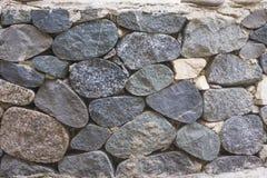 Parede das grandes pedras redondas Foto de Stock
