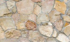 Parede das pedras como uma textura e um fundo Foto de Stock Royalty Free