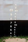 A parede de aço do metal velho do grunge com números texture o backgr abstrato Imagem de Stock