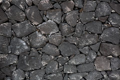 Parede de alvenaria vulcânica da pedra preta da lava Imagem de Stock Royalty Free