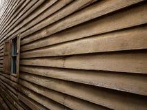 A parede de madeira e o indicador Imagem de Stock