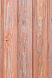 A parede de madeira envelhecida da placa com pintura vermelha desvaneceu-se Foto de Stock Royalty Free