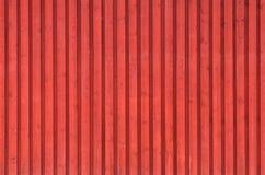 Parede de madeira rural vermelha. Textura do fundo Fotos de Stock Royalty Free