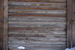 Parede de madeira velha da casa das placas Imagem de Stock