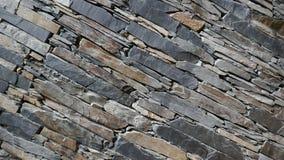 Parede de partes com cuidado empilhadas da pedra da natureza foto de stock royalty free