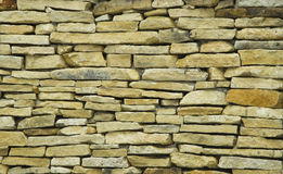Parede de pedra amarela Imagens de Stock Royalty Free