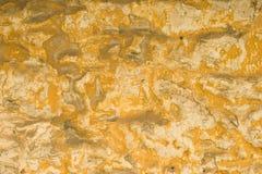 Parede de pedra amarelada Fotos de Stock