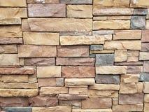 A parede de pedra bronzeia vermelhos dos pretos Fotos de Stock