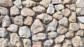 Parede de pedra de um fundo de pedra natural Imagens de Stock Royalty Free