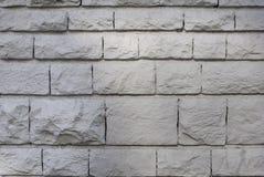 Parede de pedra desbastada velha, textura bonita do fundo imagem de stock