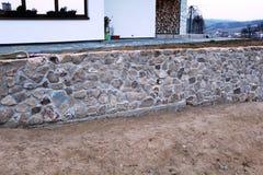 Parede de pedra na casa nova Imagens de Stock Royalty Free