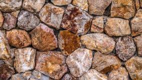 Parede de pedra no lado da praia Foto de Stock