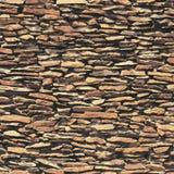 Parede de pedra, textura marrom do relevo com sombra Fotografia de Stock