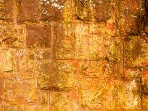 Parede de pedra velha alaranjada do fundo Fotografia de Stock