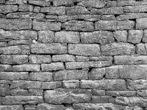 Parede de pedra velha de pedra seca sem o cimento feito do gritstone foto de stock royalty free