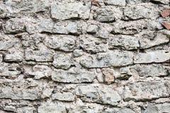 Parede de pedras grandes e de tijolos quebrados fotos de stock royalty free