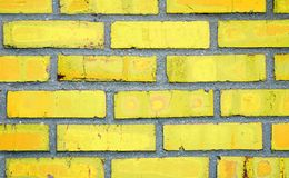 Parede de tijolo amarela imagem de stock