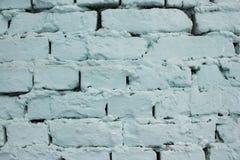 Parede de tijolo azul com textura do fundo da pintura da casca Foto de Stock