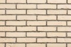Parede de tijolo bege áspera Imagem de Stock