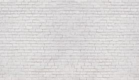 Parede de tijolo branca, textura da alvenaria clareada como um fundo fotos de stock royalty free
